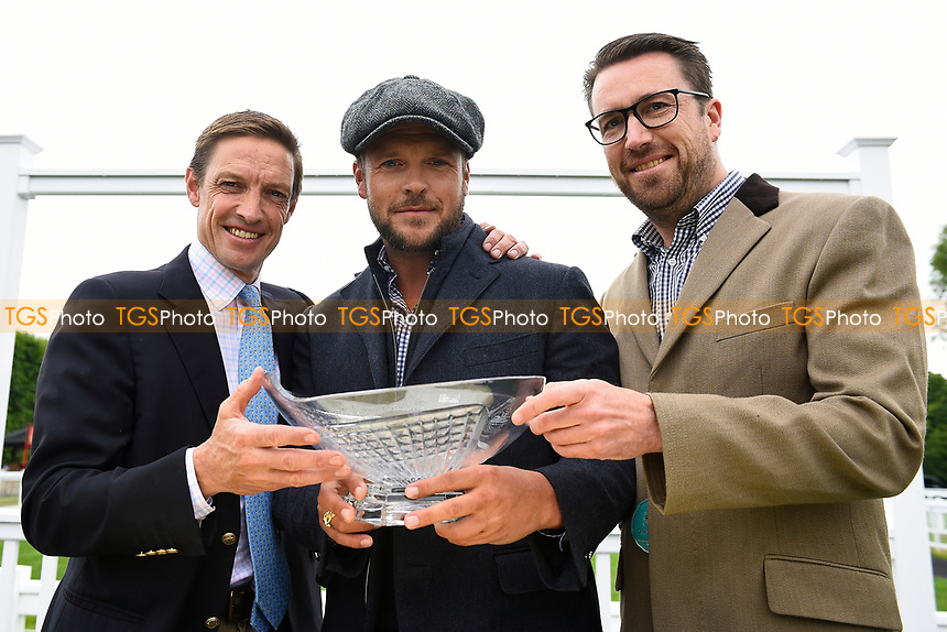 Trainer Richard Hughes with connections of See of Rome during Whitsbury Manor Stud Bibury Cup Day Racing at Salisbury Racecourse on 28th June 2017