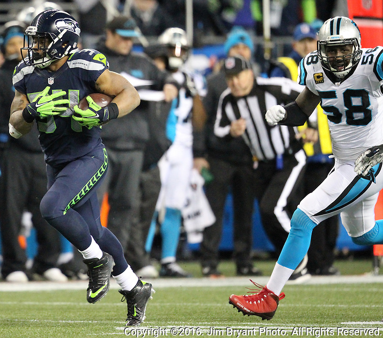 Seattle Seahawks running back Thomas Rawls (34) outruns Carolina Panthers outside linebacker Thomas Davis (58) on his way to a 45-yard touchdown in the second quarter at CenturyLink Field in Seattle, Washington on December 4, 2016. Rawls  scored two touchdowns in the Seahawks 40-7 win over the Panthers.  ©2016. Jim Bryant Photo. All Rights Reserved.