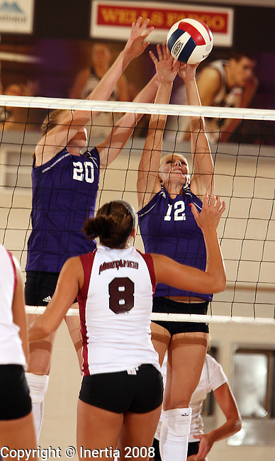 SIOUX FALLS, SD - SEPTEMBER 3:  Megan Boomgarden, #20 and Haylee Spronk, #12 for the University of Sioux Falls double team for a block on Amber Jarzynka, #8 of Morningside in the first game of their match Wednesday night at the Stewart Center. (Photo by Dave Eggen/Inertia).