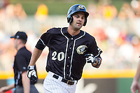 Jordan Danks (20) of the Charlotte Knights rounds the bases after hitting a home run against the Scranton/Wilkes-Barre RailRiders at BB&T Ballpark on July 17, 2014 in Charlotte, North Carolina.  The Knights defeated the RailRiders 9-5.  (Brian Westerholt/Four Seam Images)