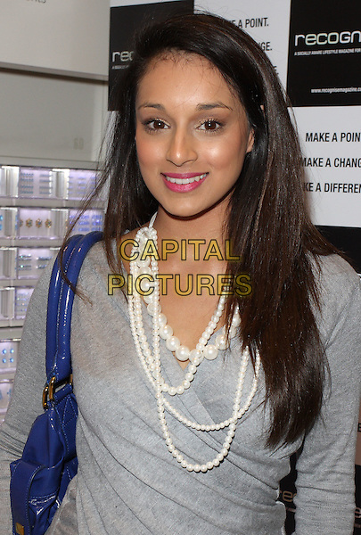 SEEMA PATHAN.'Recognise' magazine Launch Party at Swarovski Crystallized, London, England..April 13th, 2010 .half length  grey gray top white pearl necklaces blue bag purse .CAP/ROS.©Steve Ross/Capital Pictures.