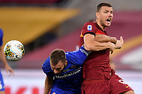 German Pezzella of ACF Fiorentina and Edin Dzeko of AS Roma compete for the ball during the Serie A football match between AS Roma and ACF Fiorentina at stadio Olimpico in Roma (Italy), July 26th, 2020. Play resumes behind closed doors following the outbreak of the coronavirus disease. <br /> Photo Antonietta Baldassarre / Insidefoto
