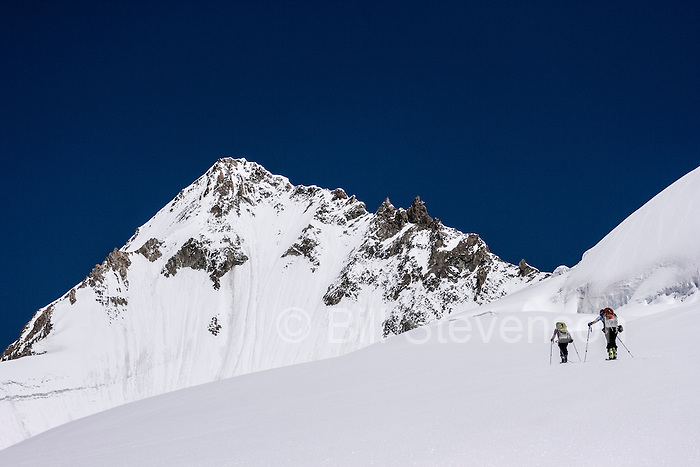 Two women skiing on the Biafo glacier in the Karakoram himalaya in Pakistan