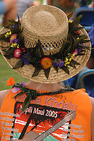 Woman wearing intricate flowered hatband made of ti leaves and flowers, Maui