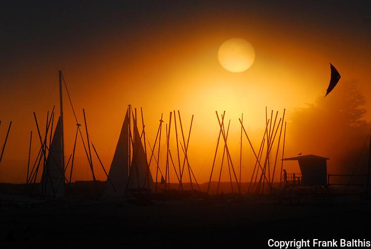 yachts and kite at sunset in Santa Cruz
