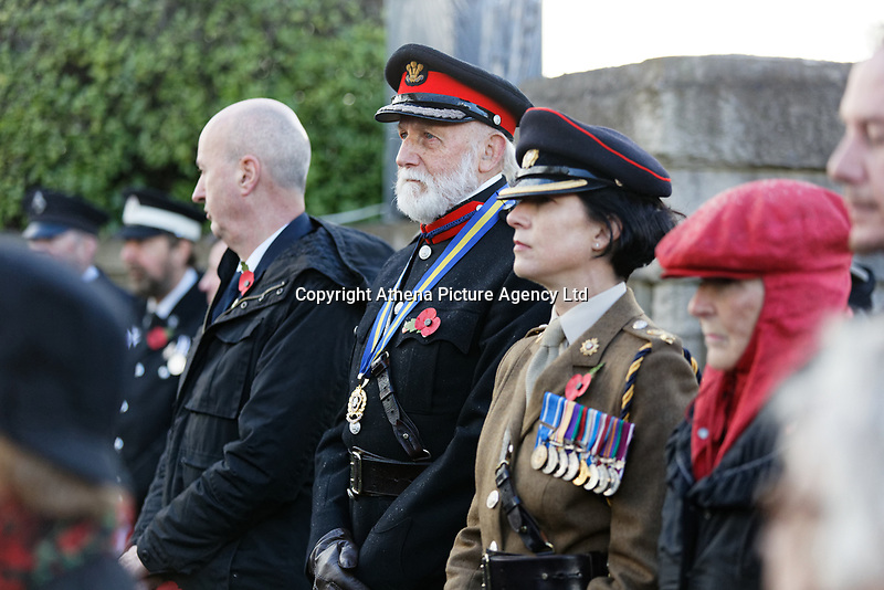 Pictured: Members of the Armed Forces join local dignitaries during the service. Sunday 11 November 2018<br /> Re: Commemoration for the 100 years since the end of the First World War on Remembrance Day at the Swansea Cenotaph in south Wales, UK.
