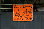"""6 November 2004: United fans display a banner stating """"Major League Baseball Sucks, MLS Rocks"""" in reference to the relocation of the Montreal Expos who will share RFK Stadium with United for at least the next two years. DC United defeated the New England Revolution 4-3 on penalties after the game ended in a 3-3 tie at RFK Stadium in Washington, DC in the Major League Soccer Eastern Conference Championship Match. ."""