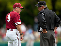 STANFORD, CA - April 23, 2011: Head coach Mark Marquess of Stanford baseball discusses a call with the first base umpire during Stanford's game against UCLA at Sunken Diamond. Stanford won 5-4