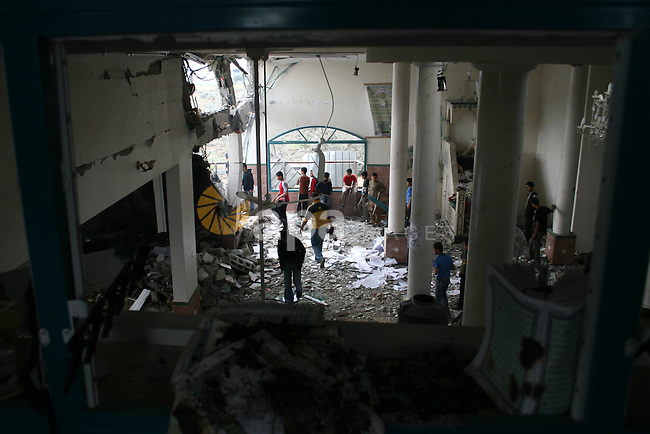 Palestinians inspect the damage to a mosque that witnesses said was targeted by Israeli troops during clashes with Palestinian gunmen in Gaza. Israeli troops killed four Hamas gunmen on Wednesday in clashes in the Gaza Strip near a terminal used to supply fuel to the coastal territory, Palestinian medical workers and Hamas said.