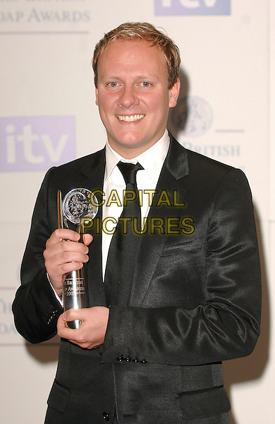 ANTHONY COTTON.Inside the Press Room at the British Soap Awards 2007, BBC Television Centre, London, England. .May 26, 2007.half length black suit jacket trophy award winner .CAP/BEL.©Belcher/Capital Pictures