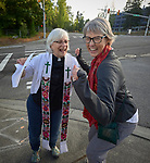 The Rev. Dr. Lyda Pierce (left) and the Rev. Mary Kohlstaedt Huycke dance as they sing outside the Federal Detention Center in Seatac, Washington, during a June 24 prayer vigil in support of immigrant parents inside the prison who've been separated from their children. Pierce is coordinator of Hispanic and Latino ministries for the Pacific Northwest annual conference of the United Methodist Church. Huycke is district superintendent of the Seven Rivers District of the United Methodist Church.