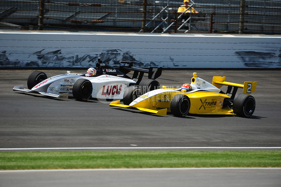 May 28, 2010; Indianapolis, IN, USA; Indy Light Series driver James Hinchcliffe (2) races alongside J.K. Vernay (7) during the Freedom 100 at the Indianapolis Motor Speedway. Mandatory Credit: Mark J. Rebilas-