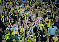 Yellow Fever fans celebrate during the A-League football match between Wellington Phoenix and Central Coast Mariners at Westpac Stadium in Wellington, New Zealand on Saturday, 4 January 2020. Photo: Dave Lintott / lintottphoto.co.nz