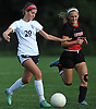 Nicole Coccia #29 of St. Dominic, left, gets pressured by Nikki Della Speranza #23 of Long Island Lutheran during a varsity girls soccer game at Charles Wang Athletic Complex in Muttontown on Monday, Oct. 3, 2016. St. Dominic won by a score of 6-4.