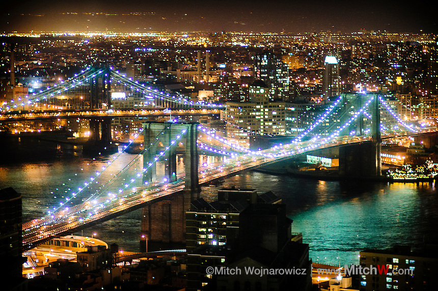 Brooklyn Bridge at night in New York City between Mahnattan at left and Brooklyn across river at right.  Manhattan bridge in background..©Mitch Wojnarowicz Photographer.Not a royalty free image. COPYRIGHT PROTECTED.www.mitchw.com.518 843 0414_Mitchw@nycap.rr.com.20090321