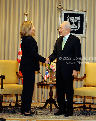 President Shimon Peres of Israel, right, shakes hands with United States Secretary of State Hillary Rodham Clinton at the Presidential Residence in Jerusalem, Israel, on Wednesday, September 15, 2010. .Credit: Department of State via CNP.