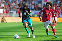 Andre Ayew of Swansea City vies for possession with Han-Noah Massengo of Bristol City during the Sky Bet Championship match between Bristol City and Swansea City at Ashton Gate in Bristol, England, UK. Saturday 21 September 2019