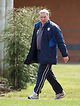 Ally McCoist walks out for training at the end of another turbulent week for his club
