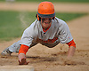 Shane Pinto #55, Carey third baseman, dives back to first base in the top of the second inning of a Nassau County varsity baseball game against host Garden City High School on Monday, May 9, 2016.