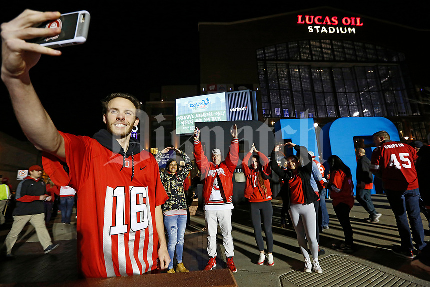 From left, Cory Deibert takes a photo of his mother Rochelle Deibert, father Todd Deibert, sister Savanna Deibert and fiance Bryn Pride, all Ohio State Buckeyes fans from Columbus, before they enter Lucas Oil Stadium prior to the Big Ten championship football game against the Wisconsin Badgers in Indianapolis on Dec. 2, 2017. [Adam Cairns / Dispatch]
