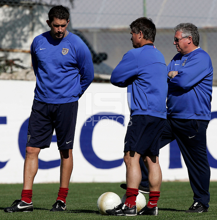 USA´s goalkeeper Mark Dougherty, left, talks with head coach Greg Ryan, middle during training at the Montechoro Hotel soccer fields in Montechoro, March 13, 2007, during the Algarve Women´s Cup.
