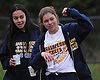 Gillian Murphy of Massapequa, an All-Long Island varsity gymnast, right, cheers on runners as she hands out water on Merrick Avenue during the Long Island Marathon on Sunday, May 1, 2016.