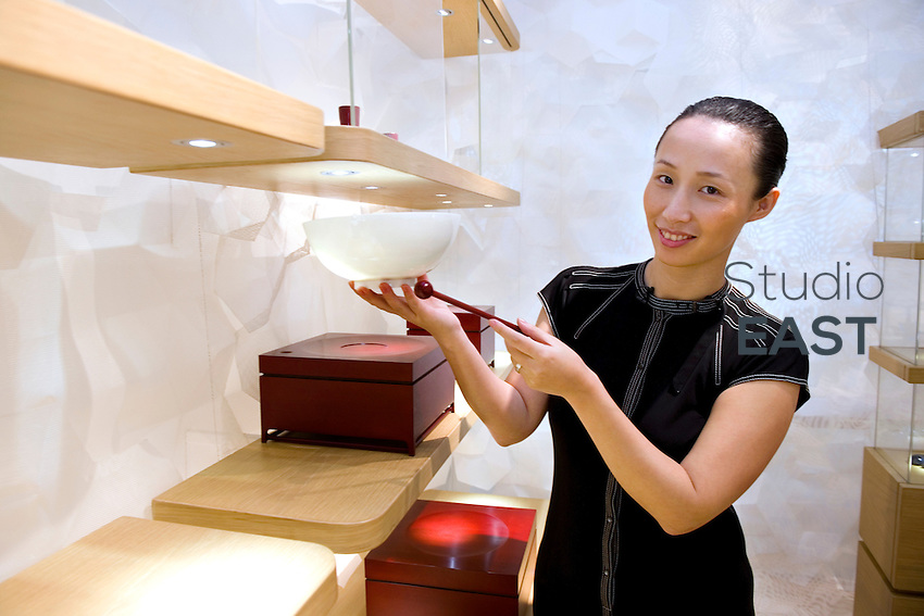 Shangxia CEO and Artistic Director JIANG Qiong Er poses with an 'egg-shell' porcelain bowl priced at 10,000 Yuans (1,142 euros) in the first store of the luxury brand, due to open tomorrow, in Shanghai, China, on September 15, 2010. Shangxia is a Chinese luxury brand launched by Hermes. Shangxia is owned by Hermes and has its own design team. It will make and sell clothes and accessories based on Chinese styles and traditional know-how. If customer reaction proves positive, Hermes plans to open a Shangxia store in Paris next year and gradually roll out worldwide. Photo by Lucas Schifres/Pictobank
