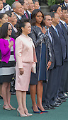 First Lady Michelle Obama and Madame Peng Liyuan of China as the the national anthems are played during an official State Arrival ceremony on the South Lawn of the White House in Washington, DC on Friday, September 25, 2015.<br /> Credit: Ron Sachs / CNP