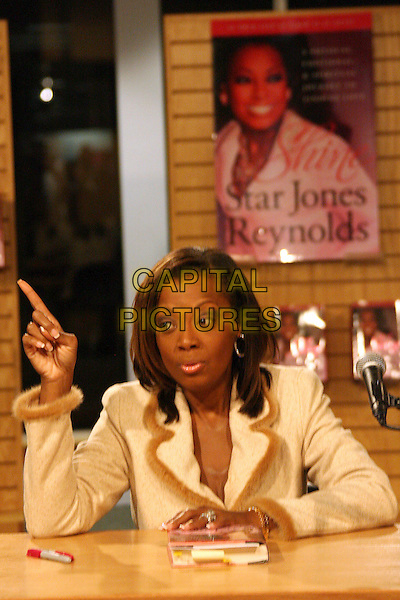 "STAR JONES REYNOLDS.Signing copies of her new book ""Shine"" held at Borders, Westwood, California, USA, .24 February 2006..half length booksigning book-signing pointing finger gesture.Ref: ADM/ZL.www.capitalpictures.com.sales@capitalpictures.com.©Zach Lipp/AdMedia/Capital Pictures."