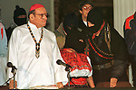 Zapatista Subcomandante Marcos talks with Comandante Ramona during the beginning of the peace talks between Mexican government envoys and Zapatista comandantes, as Bishop Samuel Ruiz looks on, at the San Cristobal Las Casas' Cathedral, February 21, 1994. The Zapatista National Liberation Army (EZLN) launched an uprising in January 1st, 1994 demanding Indian rights and opposing to the North American Free Trade Agrreement (NAFTA) signed by Carlos Salinas de Gortari with US and Canada governments. Photo by Heriberto Rodriguez