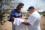 D.J. Peters signs autographs on his way to a minor league spring training game between the Los Angeles Dodgers and the Chicago White Sox in Glendale, Ariz., on Wednesday, March 21, 2018. <br /> Photo by Cathleen Allison/Nevada Momentum