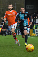 Michael Harriman of Wycombe Wanderers chases down the ball ahead of Stephen O'Donnell of Luton Town during the Sky Bet League 2 match between Wycombe Wanderers and Luton Town at Adams Park, High Wycombe, England on 6 February 2016. Photo by Claudia Nako.