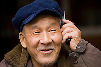 Chinese man chats on a mobile phone, Fuli Old Town, Xingping, China