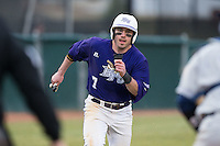 Dane McDermott (7) of the High Point Panthers scores a run against the UNCG Spartans at Willard Stadium on February 14, 2015 in High Point, North Carolina.  The Panthers defeated the Spartans 12-2.  (Brian Westerholt/Four Seam Images)