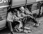 September 3, 1987 Buck Meadows, California -- Stanislaus Complex Fire -- Firefighters find a place to sit down to read the paper. The Stanislaus Complex Fire consumed 28 structures and 145,980 acres.  One US Forest Service firefighter, David Ross Erickson, died from a tree-felling accident.