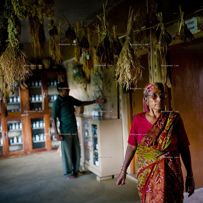 Seed bank manager, Bijadidi explains seeds and conservation as the herb garden manager, Jeetpal (left) looks on in the seed bank in Dr. Vandana Shiva's farm in Dehradun, Uttarakhand, India on 5th September 2009. ..61 year old Bija Devi, affectionately known as Bijadidi, is the 'seed bank expert', and has worked with the organization since it was founded. She's known for her knowledge of indigenous seeds. ..Dr. Vandana Shiva is a physicist turned environmentalist who campaigns against genetically modified food and teaches farmers to rely on indigenous farming methods.. .Photo by Suzanne Lee / For The National