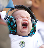 A young Sounders FC fan appears to express displeasure with the score during against Manchester United at CenturyLink Field in Seattle Wednesday July 20, 2011. Manchester United won the match 7-0.