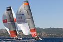 Louis Vuitton Trophy La Maddalena 25 maggio 2010. Un momento della sfida tra Luna Rossa in vantaggio ed Emirates Team New Zealand. Sullo sfondo la costa gallurese e Baia Sardinia