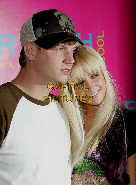 PARIS HILTON & NICK CARTER.The Shane West Birthday Celebration sponsored by Ralph Lauren, honoring Rock the Vote, at The Sunset Room in Hollywood, California.June 10, 2006.headshot, portrait, hat, baseball cap, couple, boyfriend, girlfriend, fringe.www.capitalpictures.com.sales@capitalpictures.com.©Capital Pictures