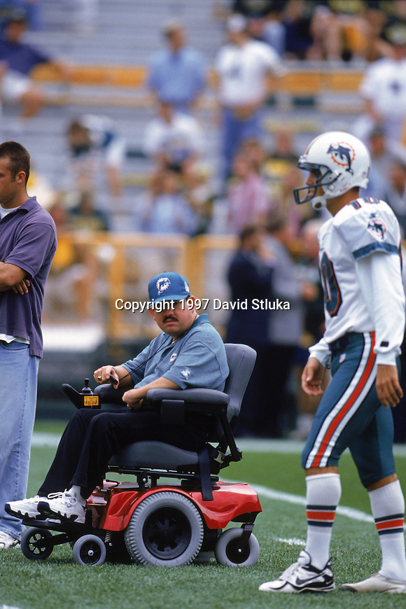 Green Bay Packers kicking coach Doug Blevins observes kicker Olindo Mare (10) during an NFL football game against the Green Bay Packers at Lambeau Field on September 14, 1997 in Green Bay, Wisconsin. The Packers defeated the Dolphins 23-18. (Photo by David Stluka/Getty Images)(Photo by David Stluka)