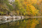 The Buffalo River displays its natural beauty, reflecting hues of autumn just before the season's peak of color. <br /> <br /> Still Water Reflections