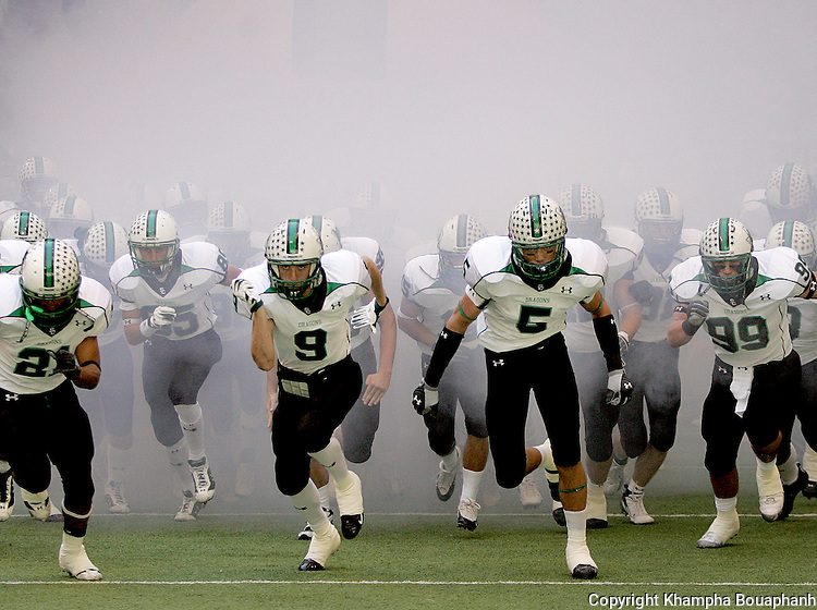 Southlake Carroll High School make their entrance for a football game against Trinity High School at Texas Stadium on  Friday, November 24, 2006.  Carroll won 22-21.  (photo by Khampha Bouaphanh)