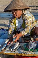 Jimbaran Beach, Bali, Indonesia.  Balinese Woman Selling Fish on the Beach, Early Morning.