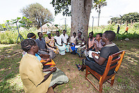 N. Uganda, Kitgum District. Peter C. Alderman Foundation project. Namokana Outreach Center where patients come for initial psychiatric assessment. Women meet as part of group therapy to discuss their problems and concerns. How to handle their grown children abusing drinking and drugs is a big concern.