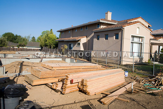A stack of wooden planks at a construction site of a residential house. Cupertino, California, USA