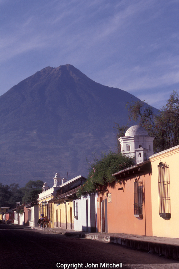 Typical street and volcano view in the Spanish colonial city of Antigua, Guatemala