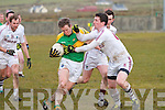 Dromids Tomás Curran puts in a strong challenge on on Skelligs Rangers man Kevin Martin.