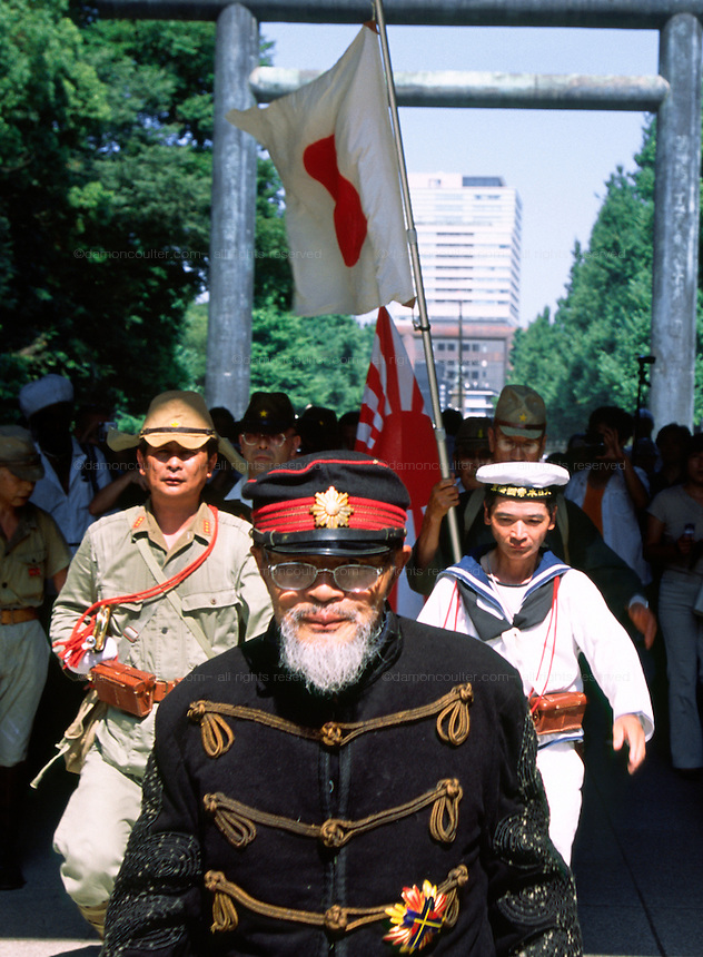 Old men in imperial army and navy uniforms march through the grounds of the  controversial Yasukuni Shrine during the celebrations of the end of the Pacific War. This shrine houses the spirits of Japan's war dead, including 14 Class A war criminals,and is a source of tension for Japanese neighbors, especially China and Korea who suffered badly at the hands of the Japanese Imperial forces before and during World War 2. Yasukuni Ginja Tokyo, Japan August 15th 2007