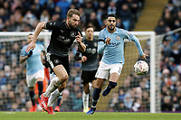 Burnley's Charlie Taylor vies for possession with  Manchester City's Riyad Mahrez<br /> <br /> Photographer Rich Linley/CameraSport<br /> <br /> Emirates FA Cup Fourth Round - Manchester City v Burnley - Saturday 26th January 2019 - The Etihad - Manchester<br />  <br /> World Copyright © 2019 CameraSport. All rights reserved. 43 Linden Ave. Countesthorpe. Leicester. England. LE8 5PG - Tel: +44 (0) 116 277 4147 - admin@camerasport.com - www.camerasport.com