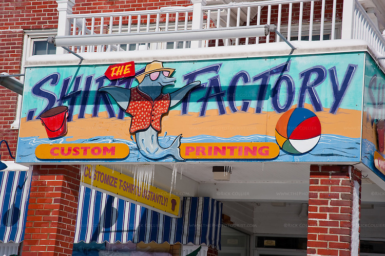 Icicles make an ironic counterpoint to the cheerful summer colors of the T-Shirt Factory sign.  (Rehoboth Beach, Delaware, USA, the morning after the February 2010 blizzard.)